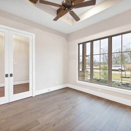 The Study - a well-lit private retreat with French doors located off of foyer
