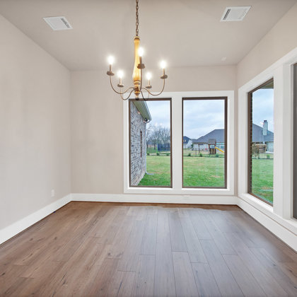 Oversized windows in dining room help bring the outside in