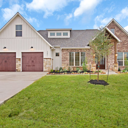 Brick, Stone, and Board & Batten Modern Farmhouse Front Elevation