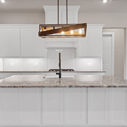 Thoughtfully designed gourmet kitchen with custom cabinets for the chef in the family