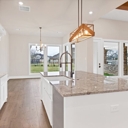 Open concept plan allows for seamless flow between kitchen, dining, and family room