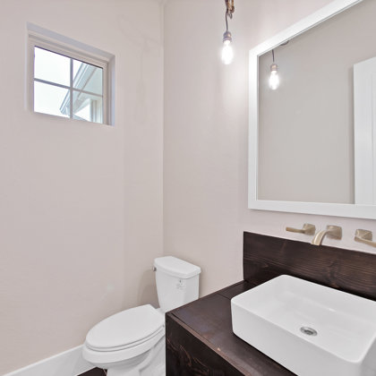 Half bath with floating vanity sink and wall mounted faucet